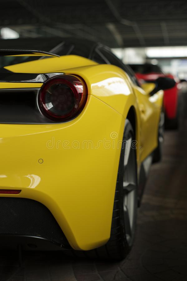 Ferrari 488 spider yellow back side view royalty free stock photography