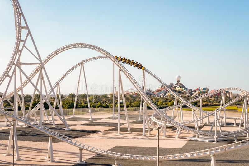 Ferrari World Yas Island, Abu Dhabi - January 2, 2018: World Fastest Rollercoaster Track, Flying Acces can be seen in distance stock image