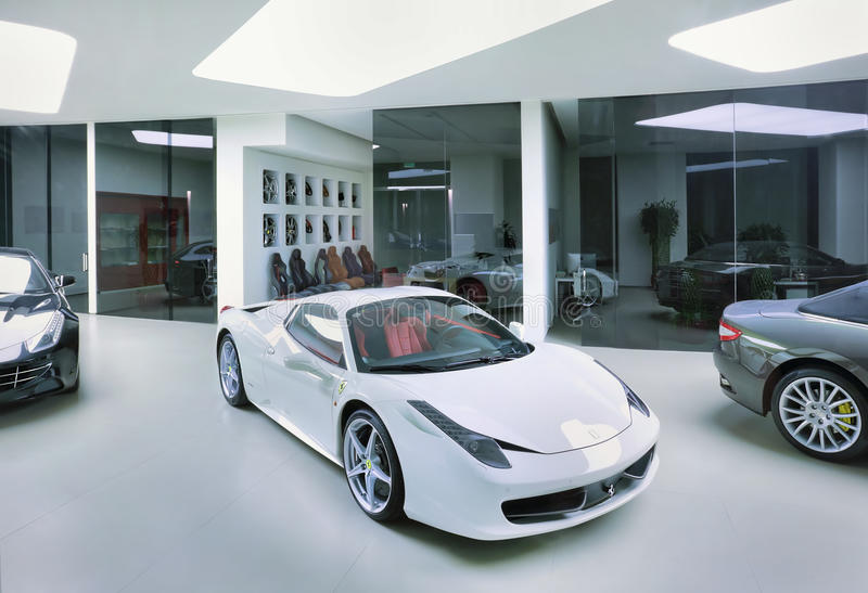 Ferraris in a modern showroom, Beijing, China. BEIJING-APRIL 6. Ferrari in a showroom. The rise of female Chinese entrepreneurs: Chinese women buy twice as many royalty free stock photography