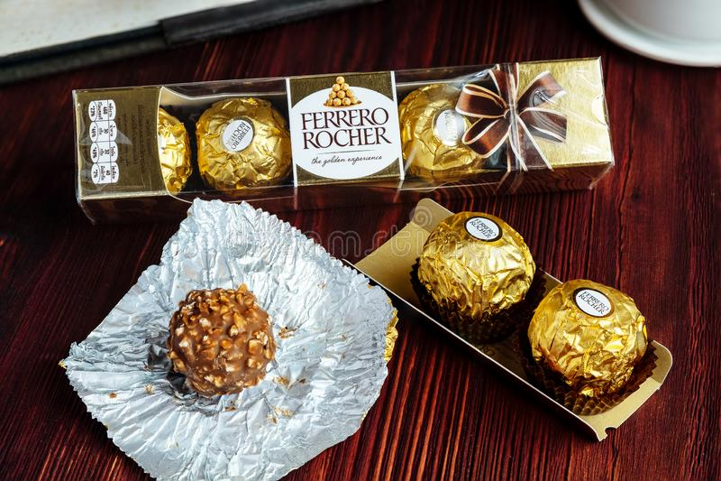 2019-02-05 Ferrero Rocher, Small Size Luxury Chocolate Snack Packs on the Wood Table for Relax Time royalty free stock photo
