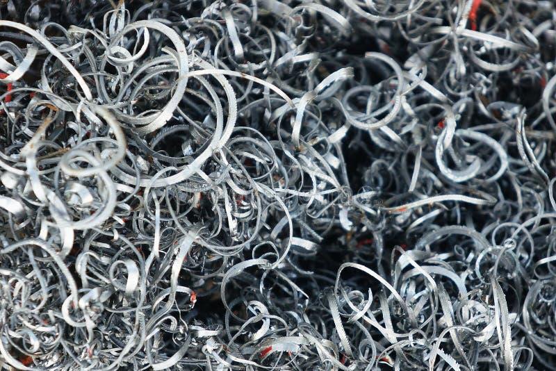 Ferreux des métaux éraflés, copeaux en métal à l'atelier photo libre de droits