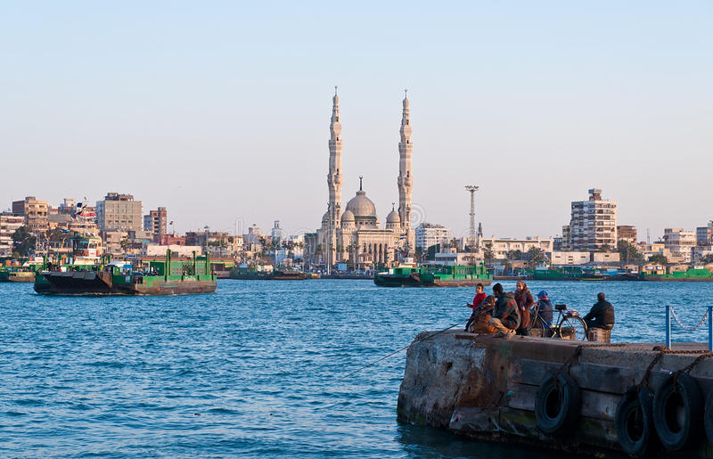Ferries crosing Suez canal in Port Said,Egypt. The ferries crossing Suez canal in Port Said,Egypt royalty free stock photo