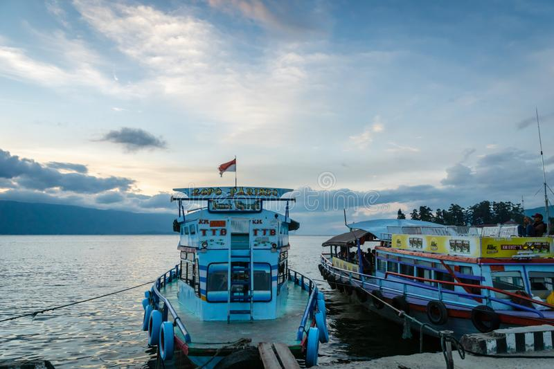 Ferries for passengers on Lake Toba at sunset, North Sumatra Indonesia. royalty free stock images