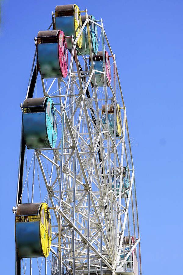 Ferries wheel. With bright blue sky in the background is captured from low angle stock photography