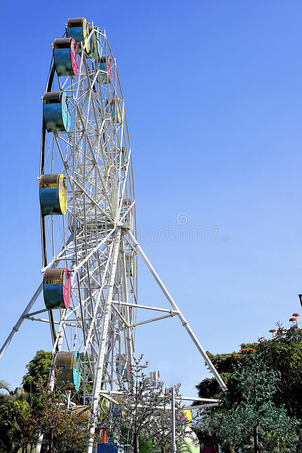 Ferries wheel. With bright blue sky in the background is captured from low angle stock images
