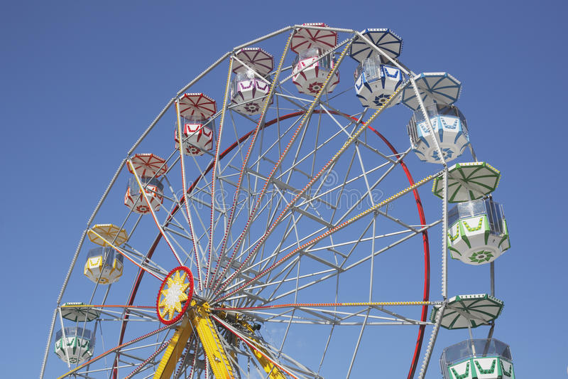 Ferris wheel. A Ferris wheel without passengers against clear blue sky royalty free stock photography