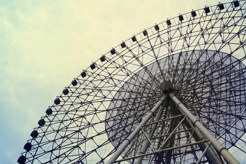 Ferris wheel. A big ferris wheel on the cloudy sky royalty free stock image