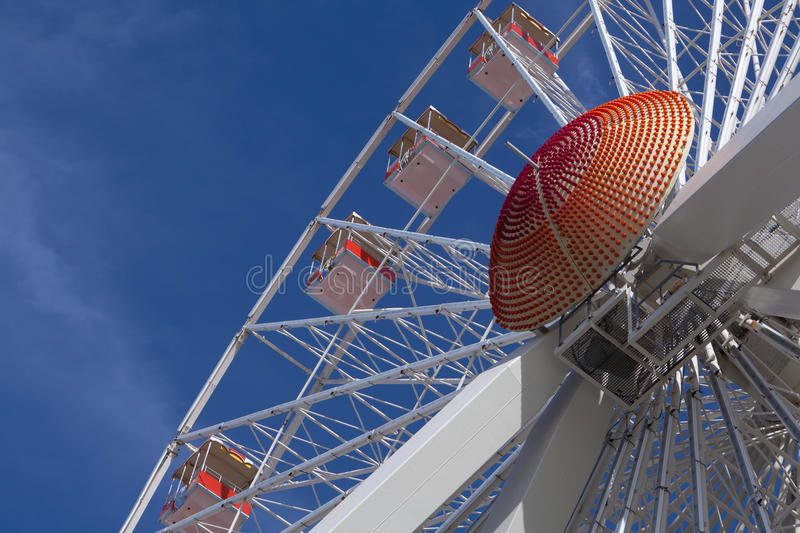 Ferris Wheel. Looking up at gondolas on a ferris wheel. Off center for copy space stock photo