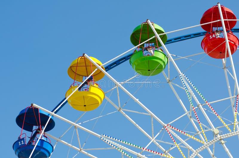 Ferris wheel. A ferris wheel in blue sky - horizontal shot, copy space royalty free stock image