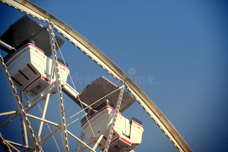 Ferris Wheel. A ferris wheel against a deep blue sky background stock photography