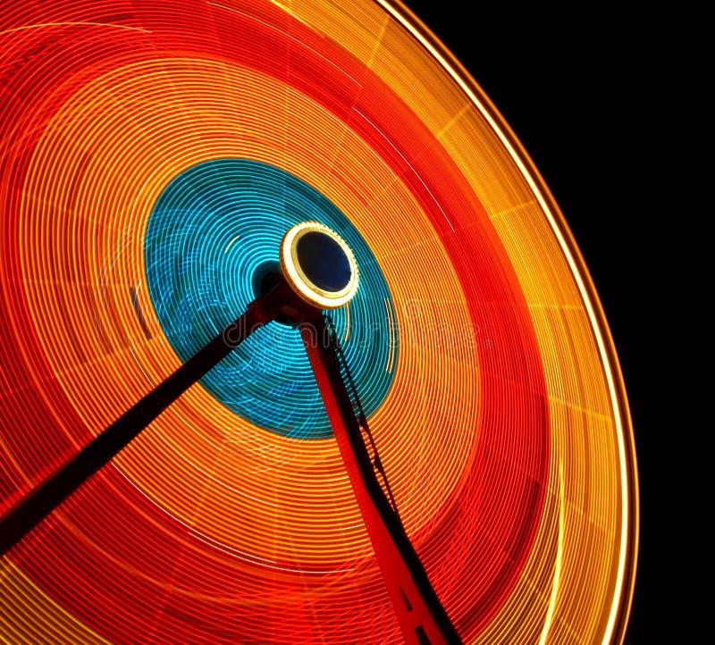 Ferris Wheel. Spinning ferris wheel against the night sky royalty free stock image