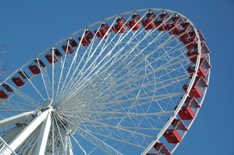 Ferris Wheel. A huge red and white ferris wheel stock photo