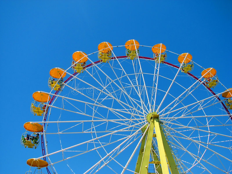 Ferris wheel. On the blue sky background royalty free stock photography
