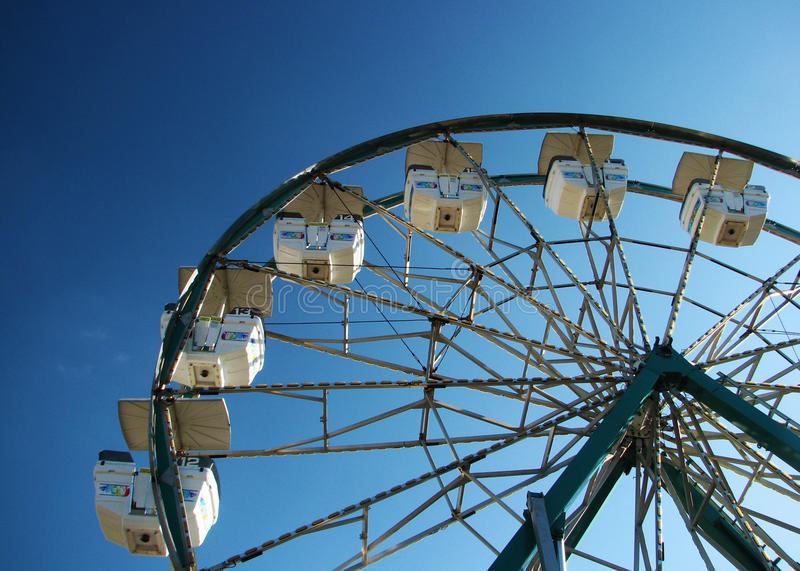 Ferris wheel against blue sky. stock photo