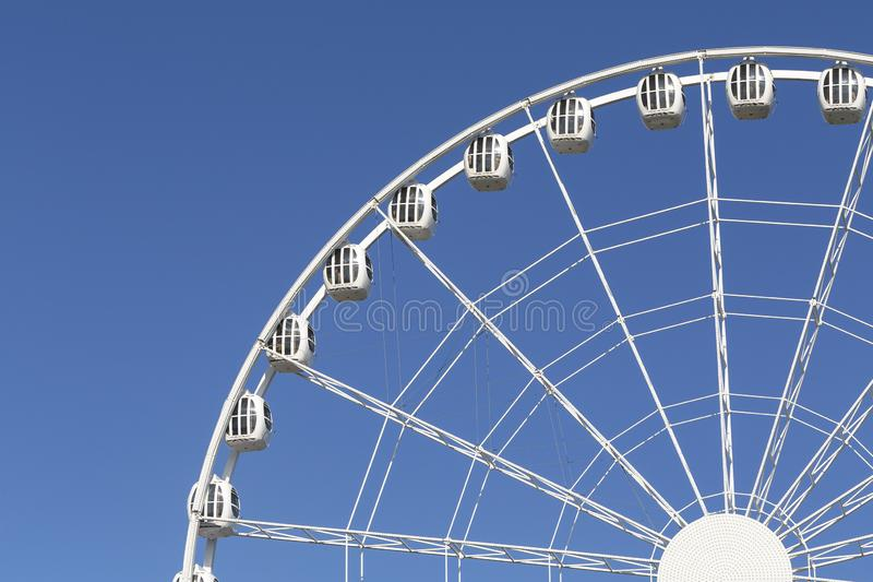 Ferris wheel of the amusement park in the blue sky background. Attraction Ferris wheel. stock image
