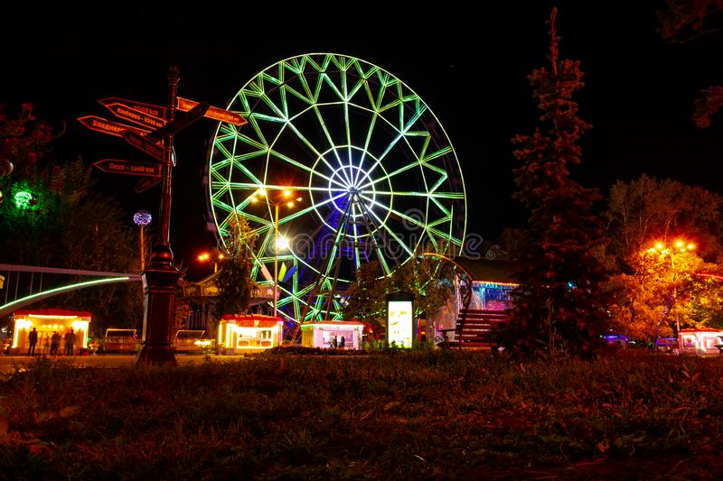 Ferris wheel on the banks of the Amur river in Khabarovsk. Russia. royalty free stock photography
