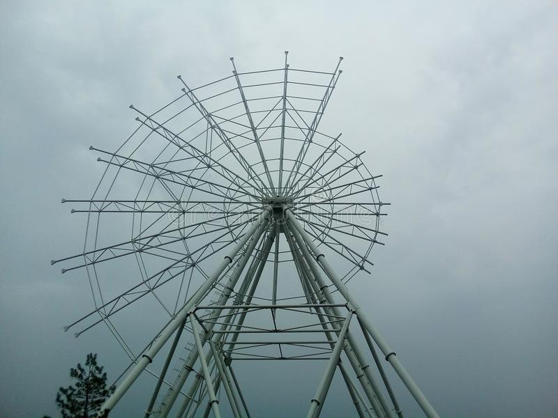 The ferris wheel being built, only half of the structure is assembled. royalty free stock images