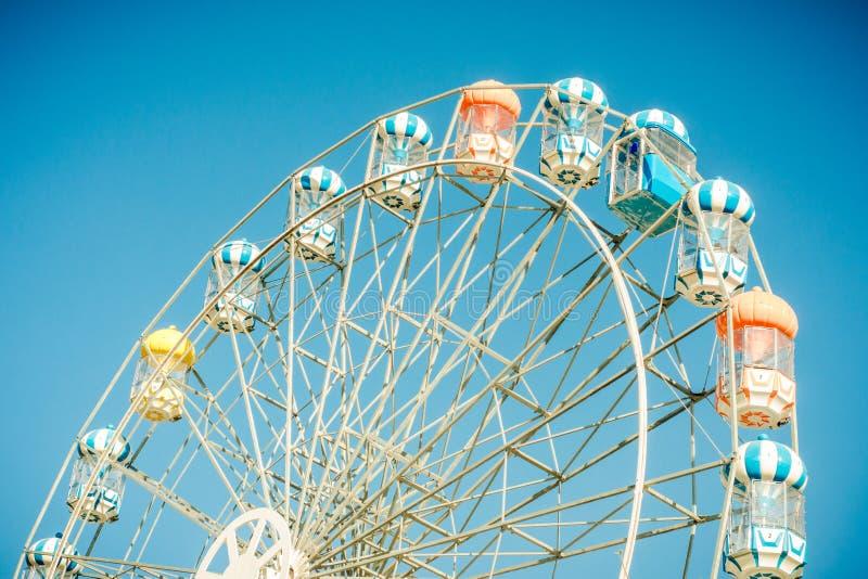Ferris wheel. A big colourful ferris wheel against a deep blue sky stock photos