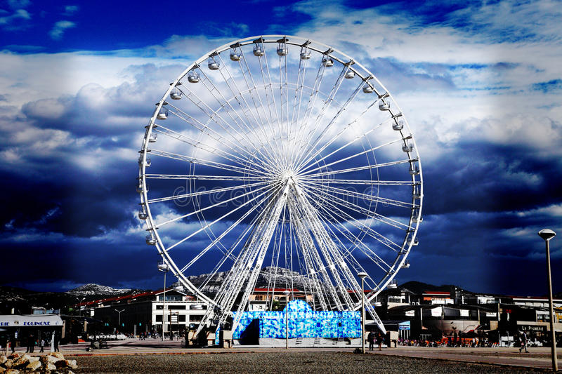 Download Ferris wheel on a blue sky editorial photo. Image of attraction - 28045976