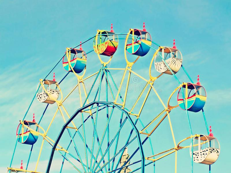Ferris wheel on blue sky backround. Colorful Ferris wheel carousel on blue sky backround taken closeup royalty free stock photography