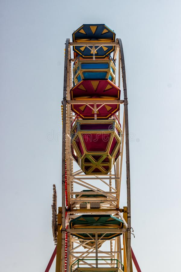 Ferris wheel with booths on blue sky background.  stock images