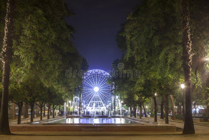 Ferris wheel on Christmas in Seville, Spain. Christmas ferris wheel at Prado de San Sebastian, Seville, Spain stock photo