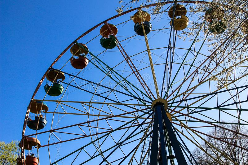 Ferris wheel in city park royalty free stock photography