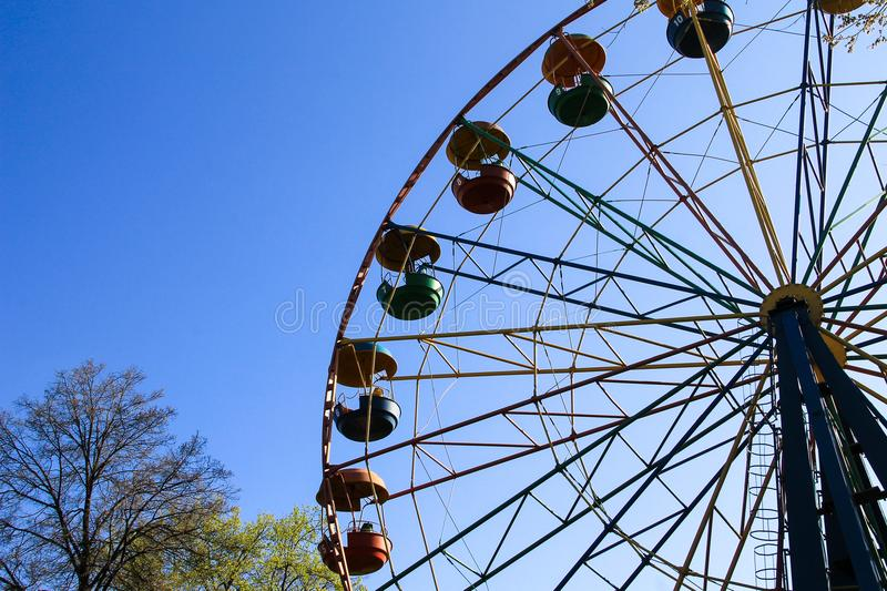 Ferris wheel in a city park royalty free stock image