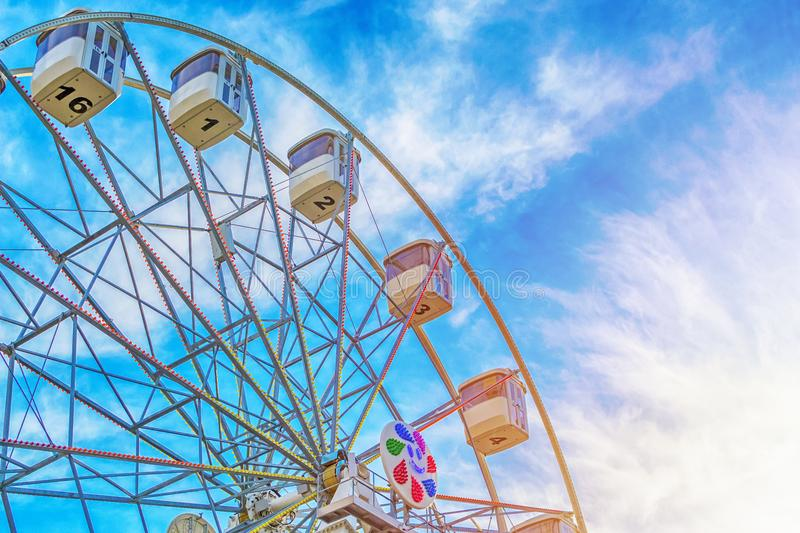 Ferris wheel on cloudy blue sky. Ferris wheel close up on cloudy blue sky with sunlight royalty free stock photos