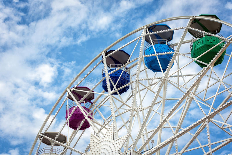Ferris wheel and cloudy sky at mount Tibidabo in Barcelona, Spain.  royalty free stock image