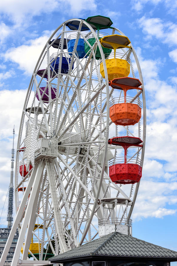 Ferris wheel and cloudy sky at mount Tibidabo in Barcelona, Spain.  stock images