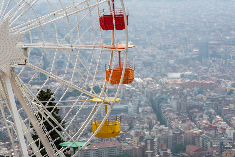 Ferris wheel and cloudy sky at mount Tibidabo in Barcelona, Spain.  royalty free stock photography