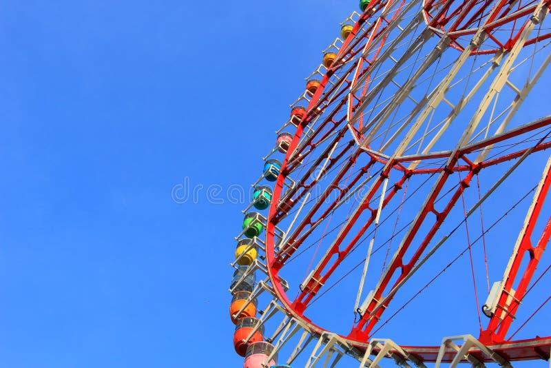 Ferris wheel and colorful gondolas. Blue sky background royalty free stock photo