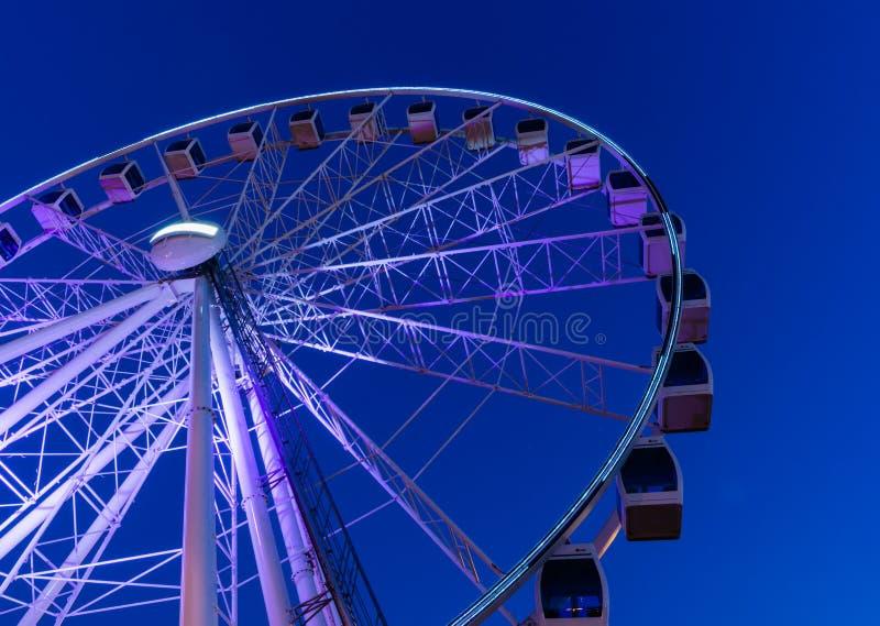 Ferris Wheel. An empty Ferris wheel at night stock images