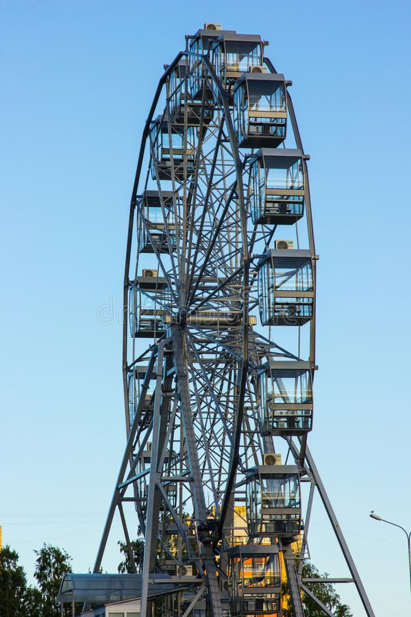 Ferris wheel, entirely against the blue sky stock images