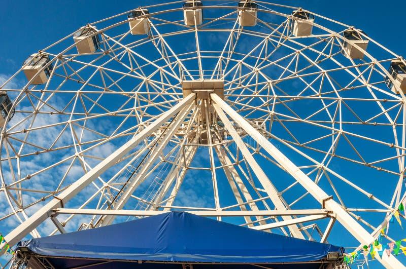 Ferris wheel at the fair against blue sky stock photos