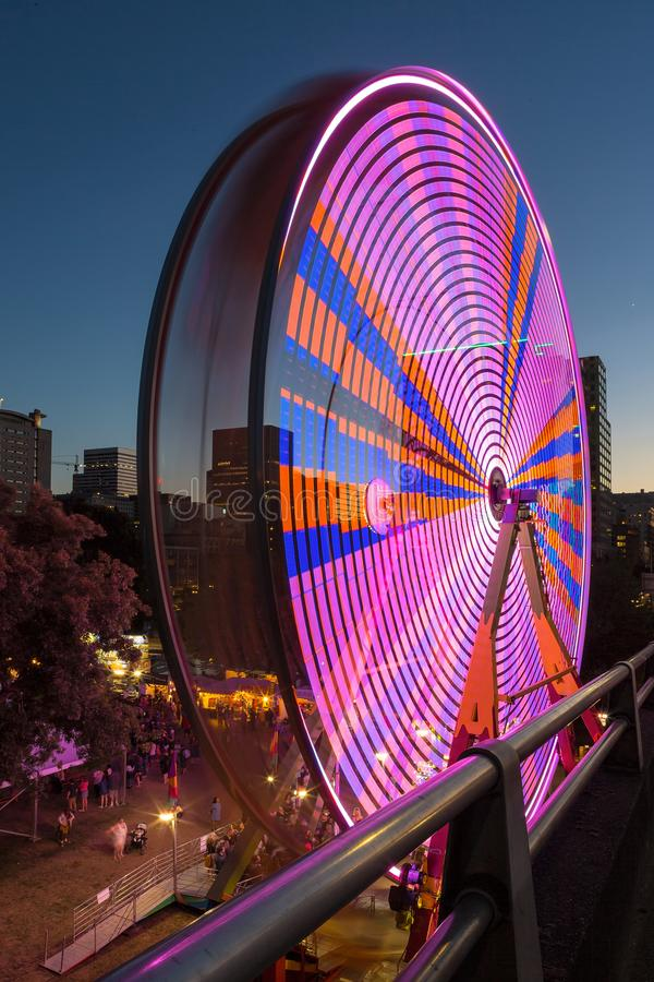 Ferris Wheel at Fun Fair in Downtown Portland Oregon. Ferris Wheel at night during Portland Rose Festival in downtown waterfront colorful lights long exposure royalty free stock images