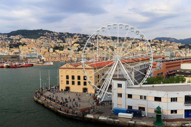 Ferris wheel in Genoa, Italy. Ferris wheel in the old harbor of Genoa Italy stock images