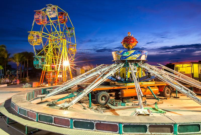 ferris wheel and gravity maching in movable amusement park at su royalty free stock images