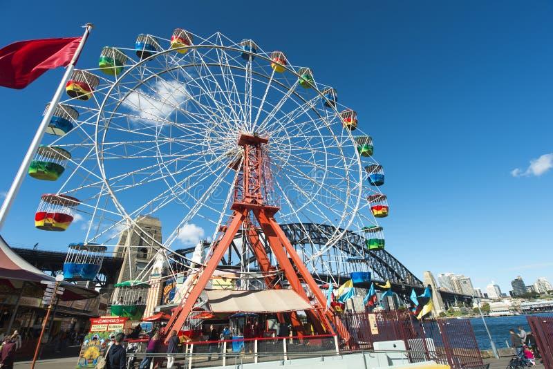Ferris Wheel and harbour bridge royalty free stock image