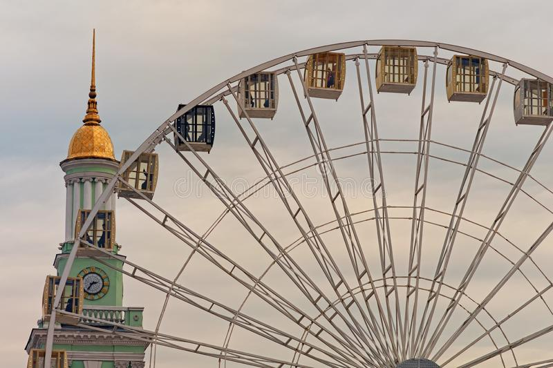 Ferris wheel in historical part of Kyiv. The bell tower of the former Greek monastery at the background. One of the most favorite squares among the locals. The royalty free stock images