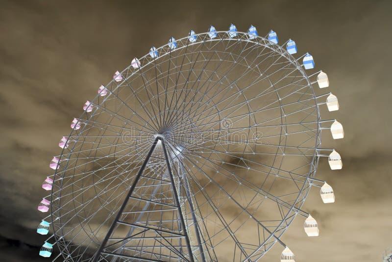 Ferris wheel in inversion royalty free stock photo