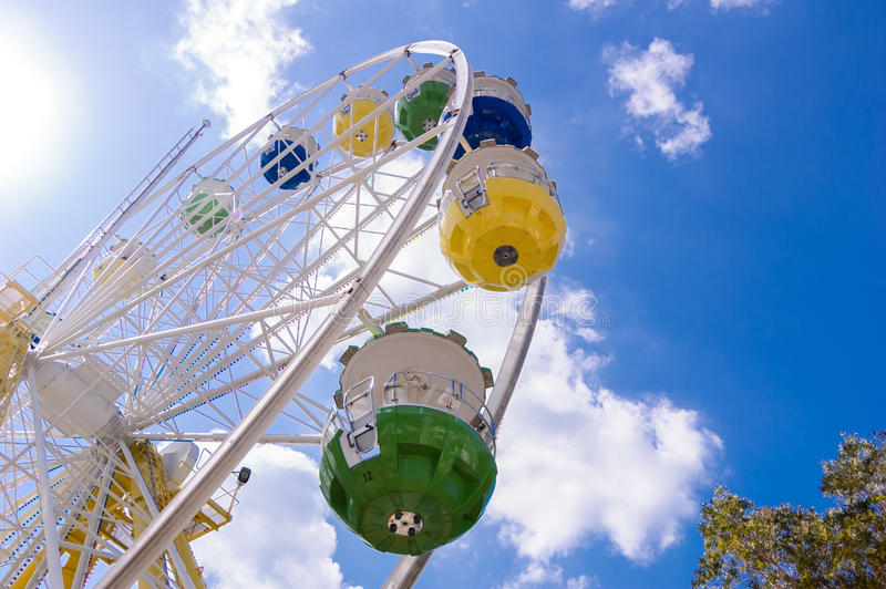 Ferris Wheel. Is a large wheel-shaped mechanical building facilities, hanging above the edge of the wheel is available for passengers traveling in the cabin royalty free stock photos