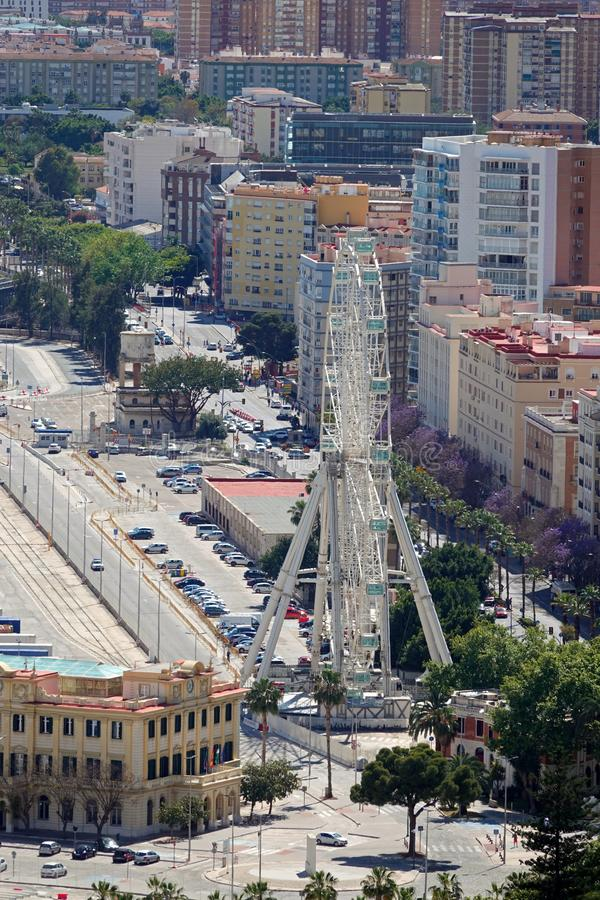 Ferris wheel in Malaga from Gibralfaro hill in Andalusia, Spain. Aerial view of the Giant Ferris wheel in the city of Malaga from the Gibralfaro hill in royalty free stock photos