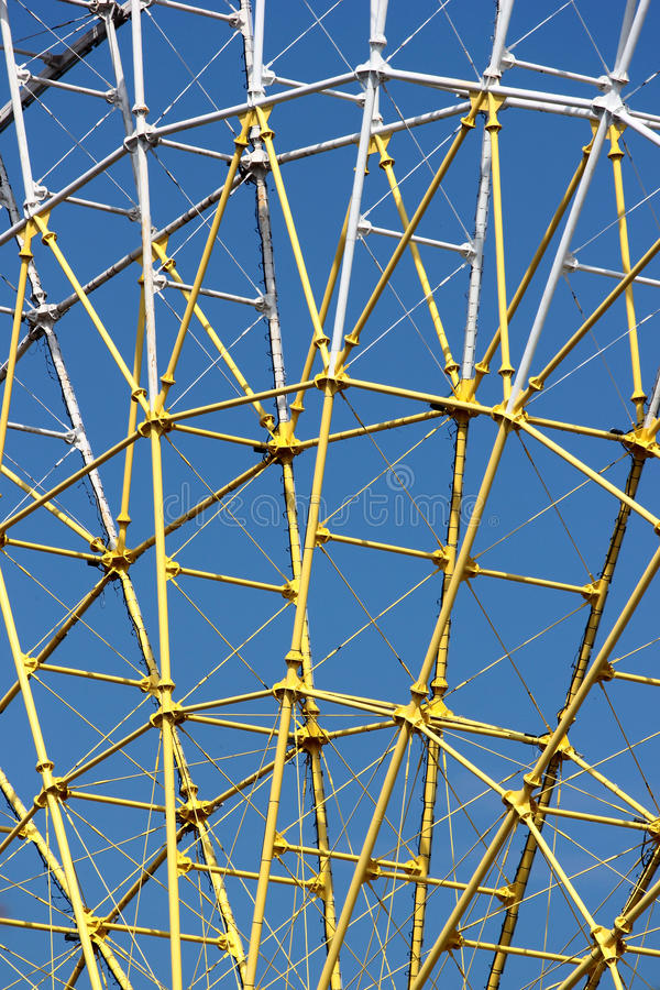 Ferris wheel metal structure against blue sky background royalty free stock photos