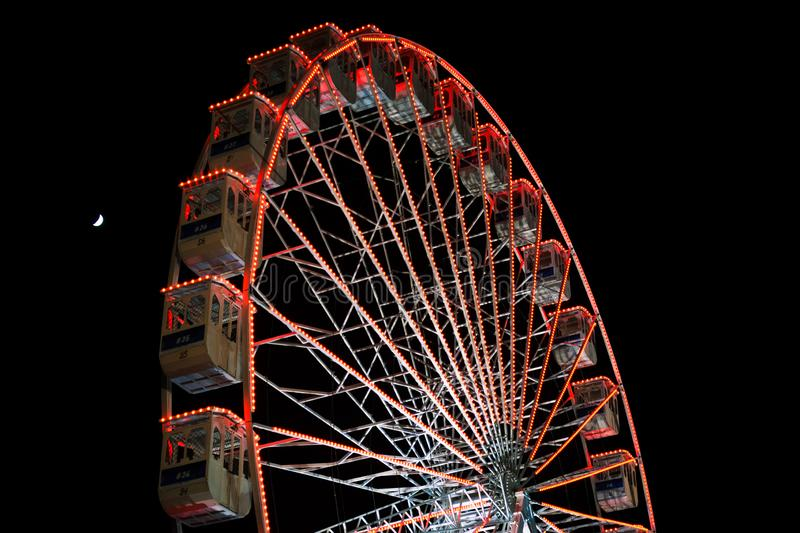 Ferris wheel and the moon. Black sky background. stock photo
