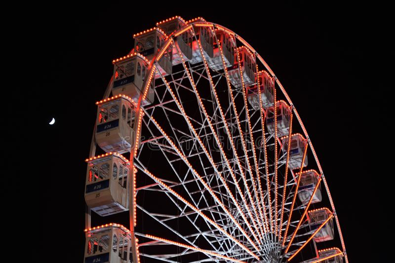 Ferris wheel and the moon. Black sky background. stock image