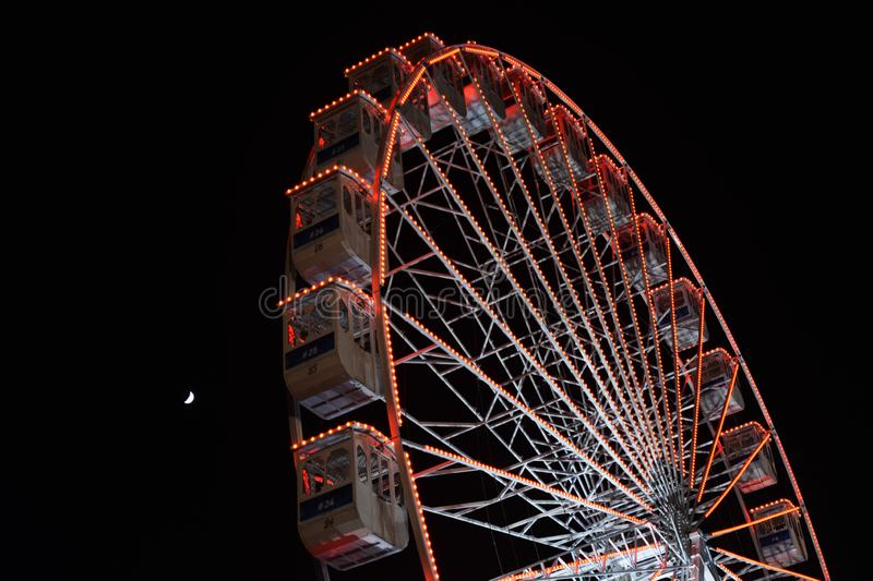 Ferris wheel and the moon. Black sky background. royalty free stock photo