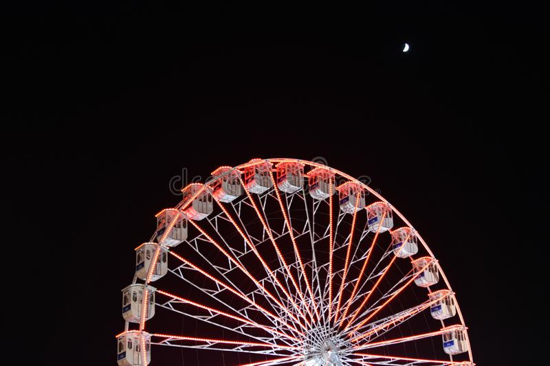 Ferris wheel and the moon. Black sky background. stock images