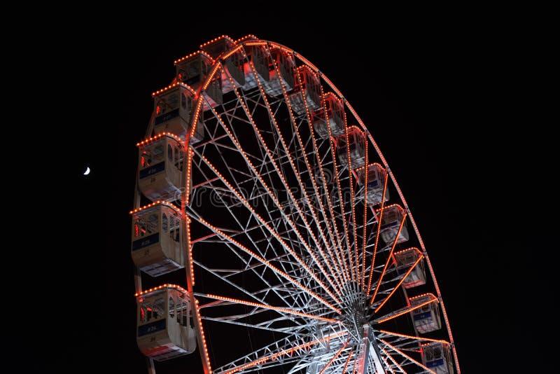 Ferris wheel and the moon. Black sky background. stock photos